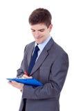 Hombre de negocios con un sujetapapeles Foto de archivo libre de regalías