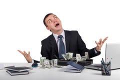 Hombre de negocios con una cartera llena de dinero en las manos aisladas en el fondo blanco Fotografía de archivo libre de regalías