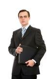 Hombre de negocios con una computadora portátil. Aislado en blanco. Fotografía de archivo libre de regalías