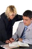 Hombre de negocios con una secretaria Imagen de archivo libre de regalías