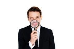 Hombre de negocios con una sonrisa magnificada Foto de archivo libre de regalías