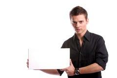 Hombre de negocios con una tarjeta blanca vacía Foto de archivo