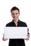 Hombre de negocios con una tarjeta blanca vacía Imagen de archivo libre de regalías