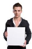 Hombre de negocios con una tarjeta blanca vacía Fotos de archivo