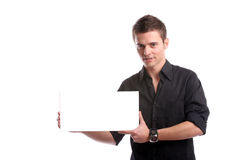 Hombre de negocios con una tarjeta blanca vacía Imagen de archivo
