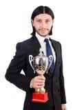 Hombre de negocios concedido con la taza premiada imagenes de archivo