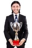 Hombre de negocios concedido con la taza premiada fotos de archivo libres de regalías