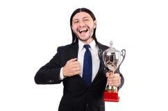 Hombre de negocios concedido con la taza premiada aislada foto de archivo