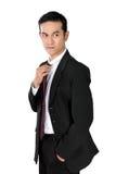 Hombre de negocios confiado en la actitud fresca, aislada en blanco Fotografía de archivo libre de regalías