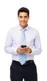 Hombre de negocios confiado Holding Smart Phone fotos de archivo
