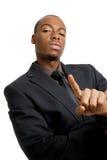 Hombre de negocios confidente con el dedo del número uno más gest Foto de archivo