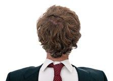 Hombre de negocios confuso de nuevo a frente, sobre blanco Foto de archivo libre de regalías