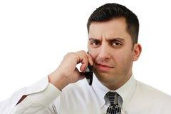 Hombre de negocios confuso en el teléfono celular imágenes de archivo libres de regalías