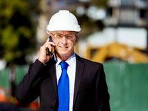 Hombre de negocios At Construction Site Fotos de archivo libres de regalías