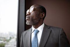 Hombre de negocios Contemplation Concept de la ascendencia africana Foto de archivo libre de regalías