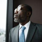 Hombre de negocios Contemplation Concept de la ascendencia africana fotografía de archivo libre de regalías