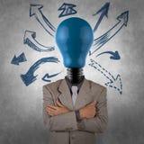Hombre de negocios creativo con la cabeza de la bombilla Fotografía de archivo