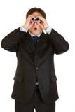Hombre de negocios dado una sacudida eléctrica que mira a través de los prismáticos Fotos de archivo libres de regalías