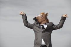 Hombre de negocios de la cabeza de caballo Imagenes de archivo