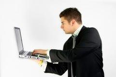 Hombre de negocios de la computadora portátil Fotos de archivo libres de regalías