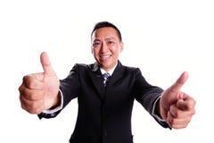 Hombre de negocios de la sonrisa con el pulgar para arriba Fotografía de archivo libre de regalías