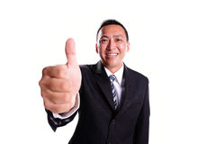 Hombre de negocios de la sonrisa con el pulgar para arriba Foto de archivo