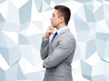 Hombre de negocios de pensamiento en el traje que toma la decisión Imágenes de archivo libres de regalías