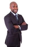 Hombre de negocios del afroamericano con los brazos plegables fotografía de archivo