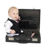 Hombre de negocios del bebé en cartera Imágenes de archivo libres de regalías