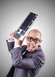 Hombre de negocios del empollón con el teclado de ordenador Imágenes de archivo libres de regalías
