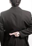 Hombre de negocios del mentiroso con los dedos cruzados Imágenes de archivo libres de regalías
