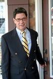 Hombre de negocios delante del hogar Imagenes de archivo