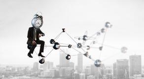 Hombre de negocios dirigido reloj Concepto de la eficacia del negocio imagen de archivo libre de regalías
