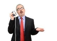 Hombre de negocios distraído imágenes de archivo libres de regalías