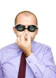 Hombre de negocios divertido con los anteojos de la natación Imagen de archivo libre de regalías