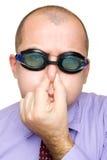 Hombre de negocios divertido con los anteojos de la natación Imagenes de archivo