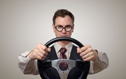 Hombre de negocios divertido en vidrios con un volante fotos de archivo