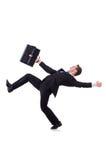 Hombre de negocios divertido que es soplado Foto de archivo libre de regalías