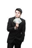 Hombre de negocios divertido que sostiene el dinero Fotos de archivo