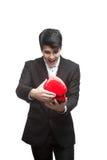 Hombre de negocios divertidos joven el el día de tarjeta del día de San Valentín Imágenes de archivo libres de regalías