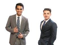 Hombre de negocios de dos jóvenes en trajes fotos de archivo