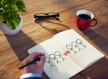 Hombre de negocios Drawing Cooperation Concept en un cuaderno de notas Fotos de archivo libres de regalías