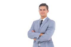 Hombre de negocios elegante con los brazos cruzados Imágenes de archivo libres de regalías