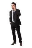 Hombre de negocios elegante que contesta a su teléfono Fotografía de archivo