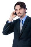 Hombre de negocios elegante que habla en su teléfono móvil Fotos de archivo libres de regalías