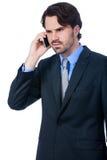 Hombre de negocios elegante que habla en su teléfono móvil Foto de archivo