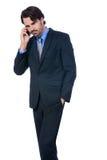 Hombre de negocios elegante que habla en su teléfono móvil Fotos de archivo
