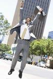 Hombre de negocios emocionado Jumping Imágenes de archivo libres de regalías