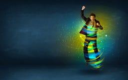 Hombre de negocios emocionado que salta con las líneas coloridas de la energía Imágenes de archivo libres de regalías