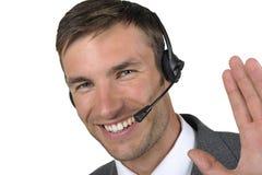 Hombre de negocios en auriculares con un micrófono Fotografía de archivo